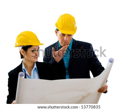Young architects looking at blueprint. Isolated on white background. - stock photo