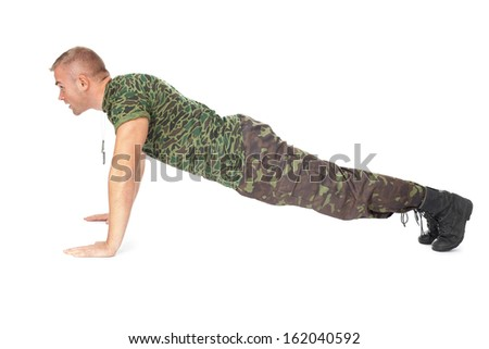 Young army soldier doing push up isolated on white background. Side view - stock photo