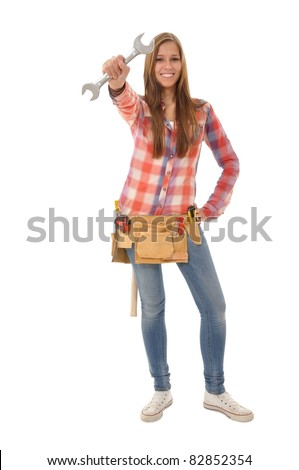 Young artisan holds a wrench in the air - stock photo