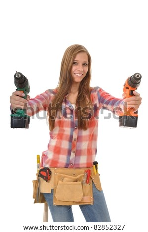 Young artisan with a tool belt shows two drill - stock photo