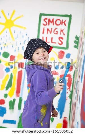 Young Artist painting with a smile on her face