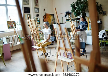 Young artists busy with painting at art studio