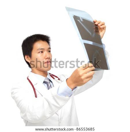 Young asia doctor checking x-ray carefully