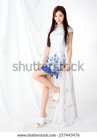 Young asia woman wearing chinese qipao dress - stock photo