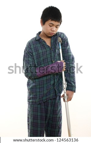 Young asian american boy with broken arm - stock photo