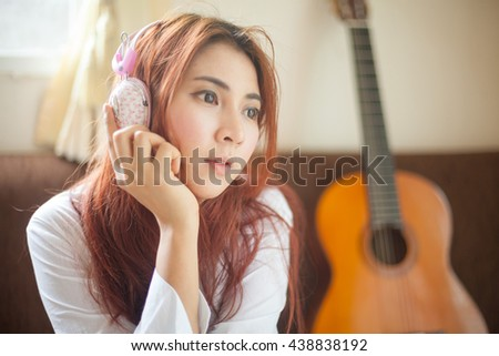 Young asian beautiful woman listening to music