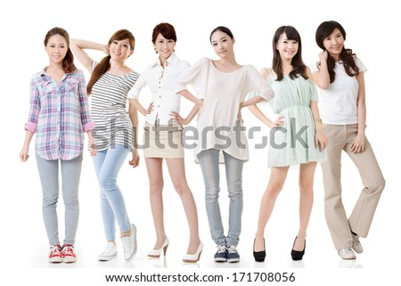 Young asian beautiful women posing for the camera. Full length portrait. Isolated on the white background. - stock photo