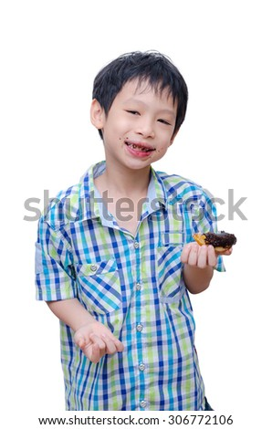 Young Asian boy eating donut over white