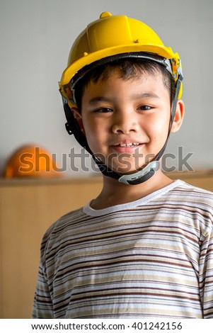 Young asian boy engineer wear a protective helmet.
