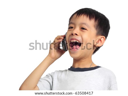 Young Asian boy laughing on cell phone. Isolated on white background.