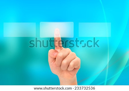 Young Asian boy locked hand touching button on a touch screen interface - stock photo
