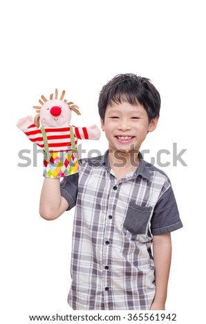 Young Asian boy playing with puppet - stock photo