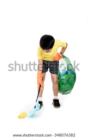 Young Asian boy use metal pinch to collect garbage in plastic bag for eliminate on the white background - stock photo
