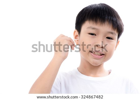 Young asian boy use white cotton bud to clean his ear by himself
