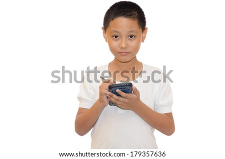 young asian boy writing something to his smart phone - stock photo