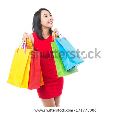 Young asian brunette woman with shopping bags on white background - stock photo