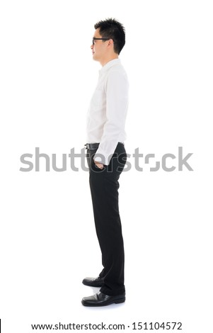 Young Asian business man full body side view isolated on white background - stock photo
