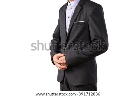 Young asian business man in black suit standing isolated on white background