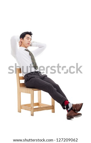 Young Asian business man sitting on the chair and fall a sleep  isolated on white background. - stock photo