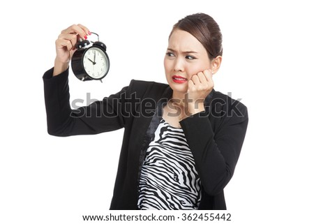 Young Asian business woman is  stressed with a clock  isolated on white background