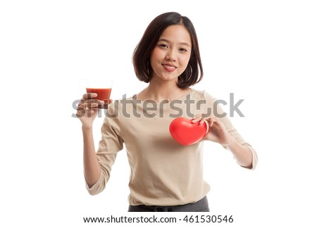 Young Asian business woman with tomato juice and red heart  isolated on white background .