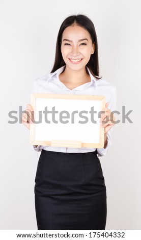 Young asian business women show empty board