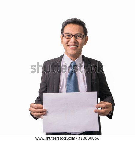 Young asian businessman holding blank board, isolated on white background - stock photo