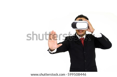 Young asian businessman in black suit wearing VR virtual reality headset, business technology concept for future, isolated on white background.