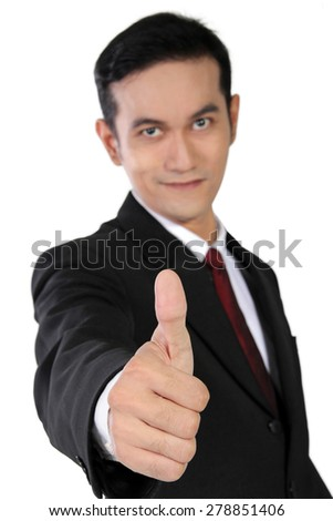 Young Asian businessman smiling and giving a thumb up, isolated on white background - stock photo