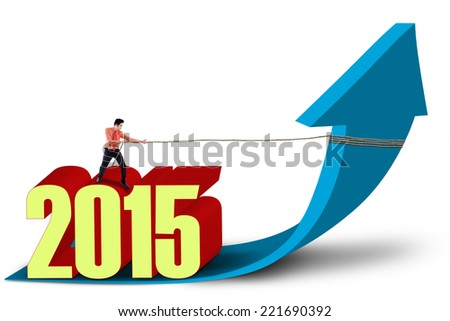 Young asian businessman with number 2015 pulling upward arrow - stock photo