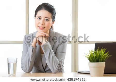 Young asian businesswoman and glass of water in office - stock photo