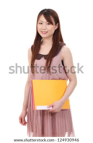 Young asian businesswoman holding file document isolated on white background - stock photo