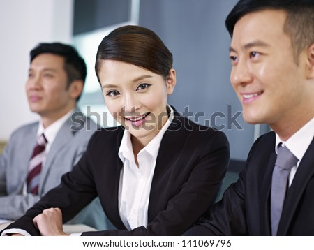 young asian businesswoman in a meeting. - stock photo