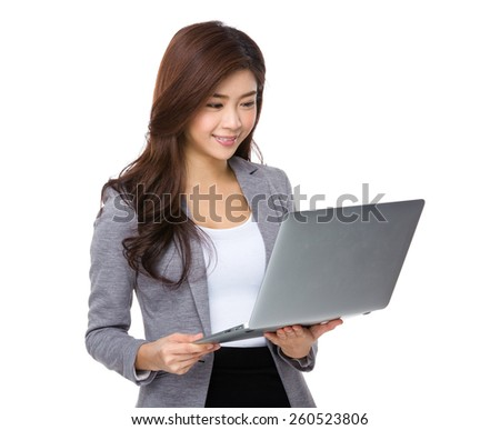 Young asian businesswoman look at notebook computer - stock photo