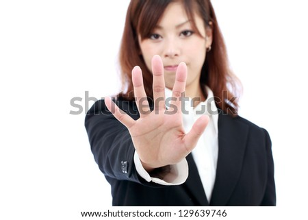 Young asian businesswoman making stop sign - stock photo