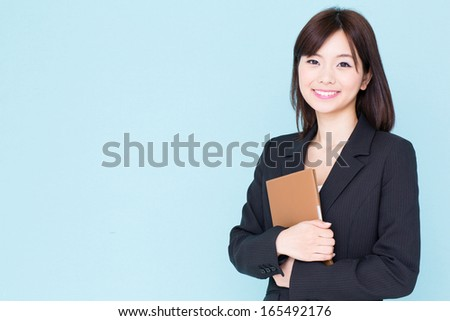 young asian businesswoman on blue background