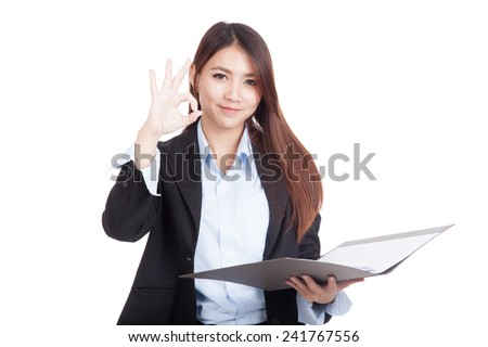 Young Asian businesswoman show OK with folder  isolated on white background - stock photo
