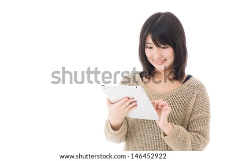 young asian businesswoman using tablet computer on white background