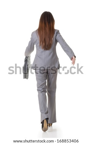 Young asian businesswoman walking with a handbag. Rear view. Isolated on the white background. - stock photo