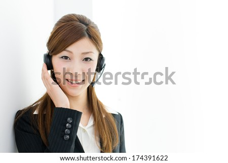 young asian businesswoman with headset - stock photo