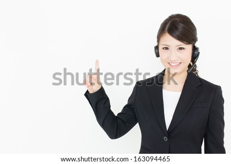 young asian businesswoman with headset showing on white background