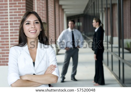Young asian businesswoman with her team in the background