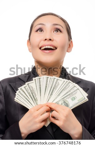 Young asian businesswoman with money on white background
