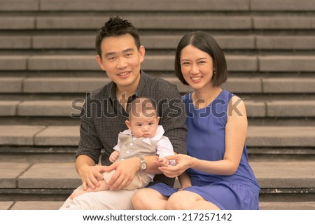 Young Asian Chinese family with 5 month old son - stock photo