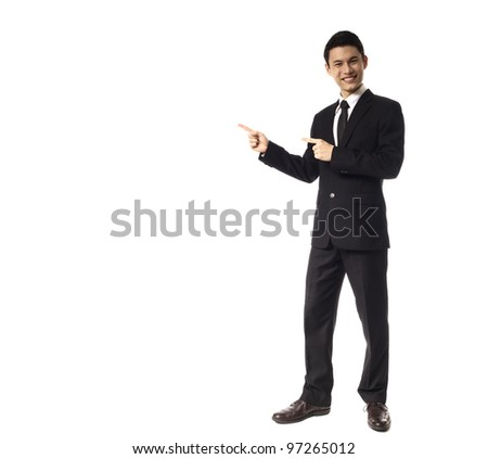 Young Asian Corporate Man pointing wit two fingers over white background