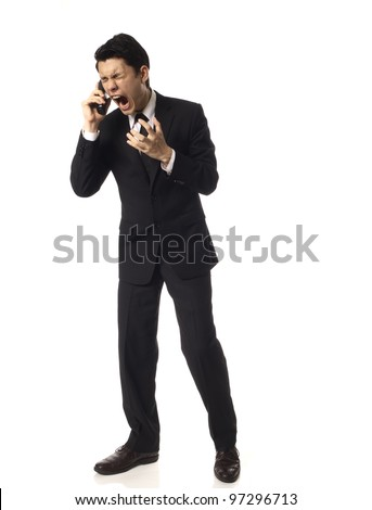 Young Asian Corporate Man shouting into Phone Over White Background