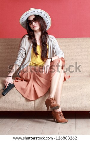 Young asian cute woman with semi-automatic pistol