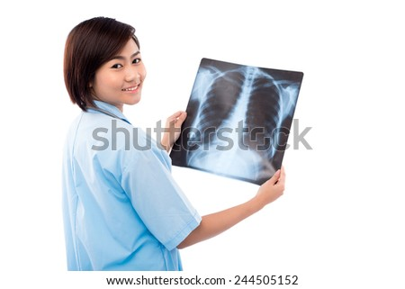 Young Asian doctor holding chest X-ray - stock photo