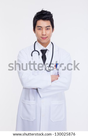 Young Asian doctor isolated on white background.