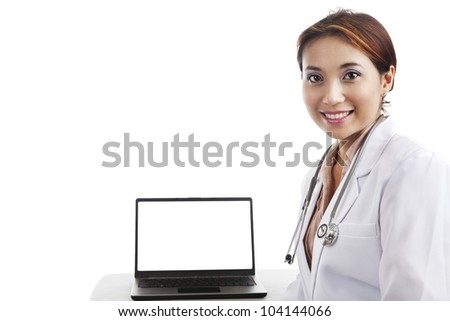 Young asian doctor with laptop shot in studio isolated on white